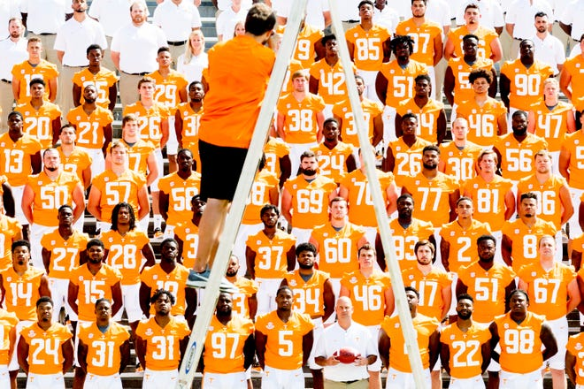 UT photographer Austin Perryman takes the official team photo during Tennessee Vols media day at Neyland Stadium in Knoxville, Tennessee on Sunday, August 5, 2018.
