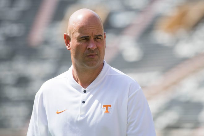 University of Tennessee head coach Jeremy Pruitt walks on the field during media day in Neyland Stadium at University of Tennessee, Sun. Aug. 5, 2018.