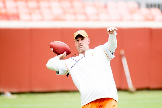 Tennessee Head Coach Jeremy Pruitt throws the ball during a drill at Tennessee Vols Fan Day at Neyland Stadium in Knoxville, Tennessee on Sunday, August 5, 2018.