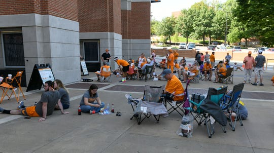 Fans line up outside Neyland Stadium at 10:30 a.m. waiting for the gate to open at 1:30 p.m. for Fan Day Sunday, August 5, 2018.