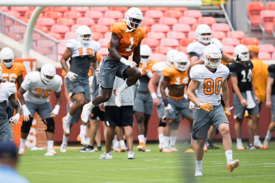 Tennessee linebacker Jonathan Kongbo (1) jumps high during fan day in Neyland Stadium at University of Tennessee Sunday, Aug. 5, 2018.