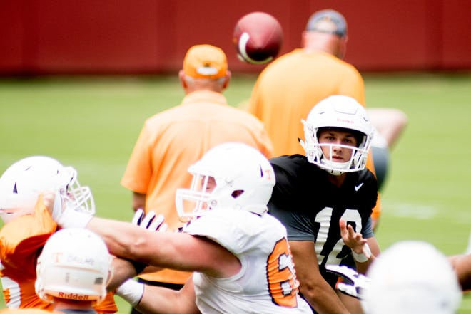 Tennessee quarterback JT Shrout (12) throws a pass during Tennessee Vols Fan Day at Neyland Stadium in Knoxville, Tennessee on Sunday, August 5, 2018.