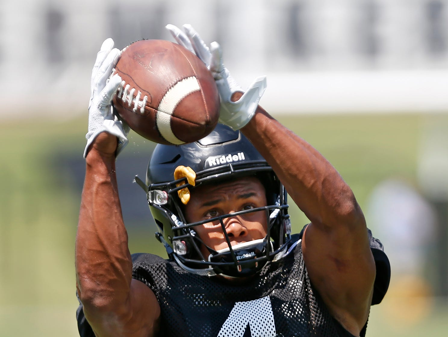 Wide receiver Rondale Moore leaps to make a catch during football practice Sunday, August 5, 2018, at Purdue.