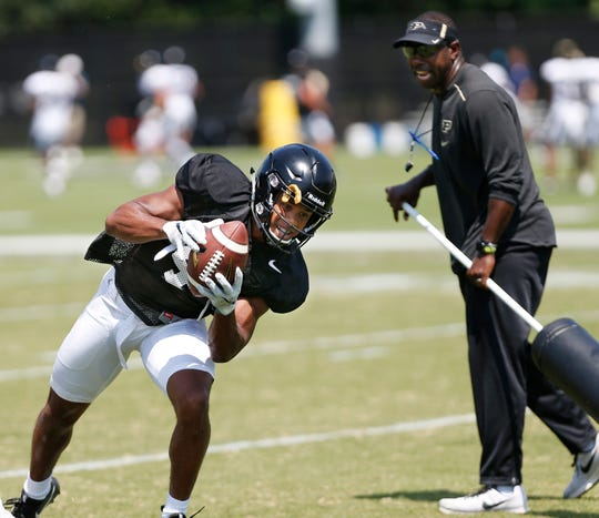 Wide receiver Rondale Moore with a catch in front of wide receivers coach and co-offensive coordinator Jamarcus Shephard during football practice Sunday, August 5, 2018, at Purdue.