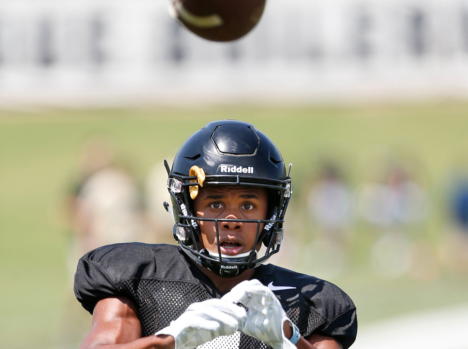 Wide receiver Rondale Moore focuses on the ball before making a catch during football practice Sunday, August 5, 2018, at Purdue.