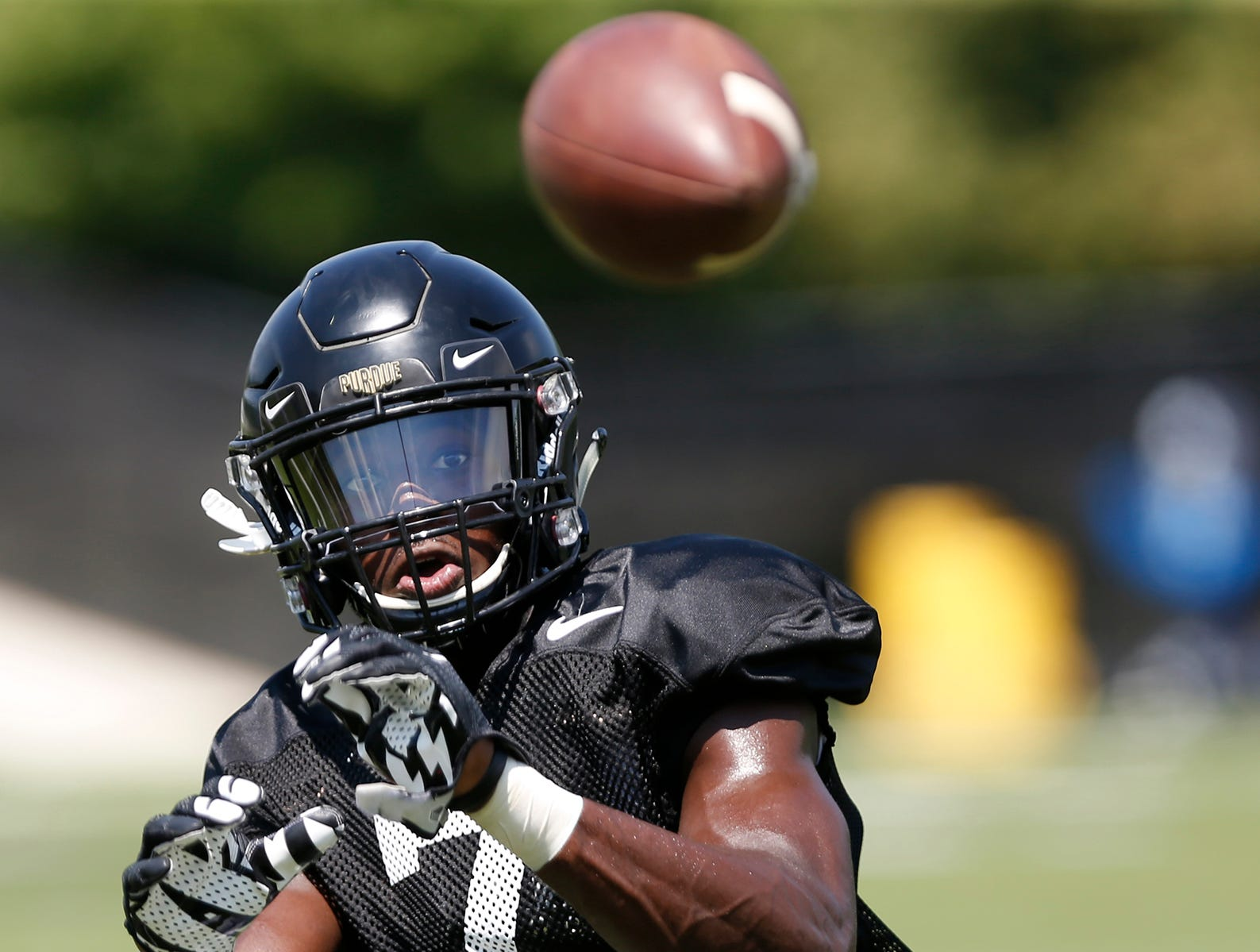 Wide receiver Isaac Zico watchs the ball into his hands to make a catch during football practice Sunday, August 5, 2018, at Purdue.