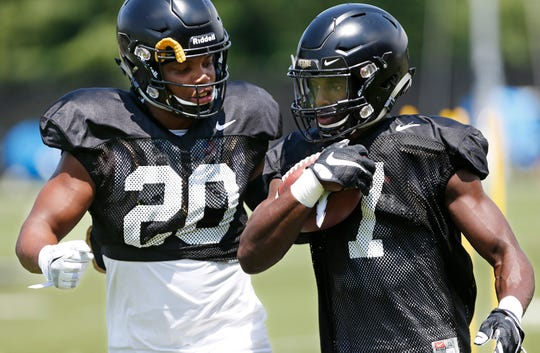 Wide receivers Benaiah Franklin, left, and Isaac Zico run a drill to protect the ball during football practice Sunday, August 5, 2018, at Purdue.
