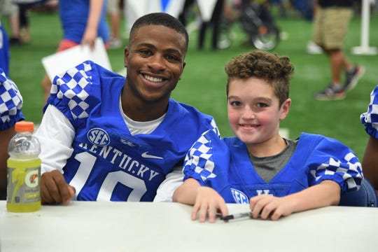 Akeem Hayes poses with 11 year-old UK football signee, Luke Klausing, at UK football Fan Day.