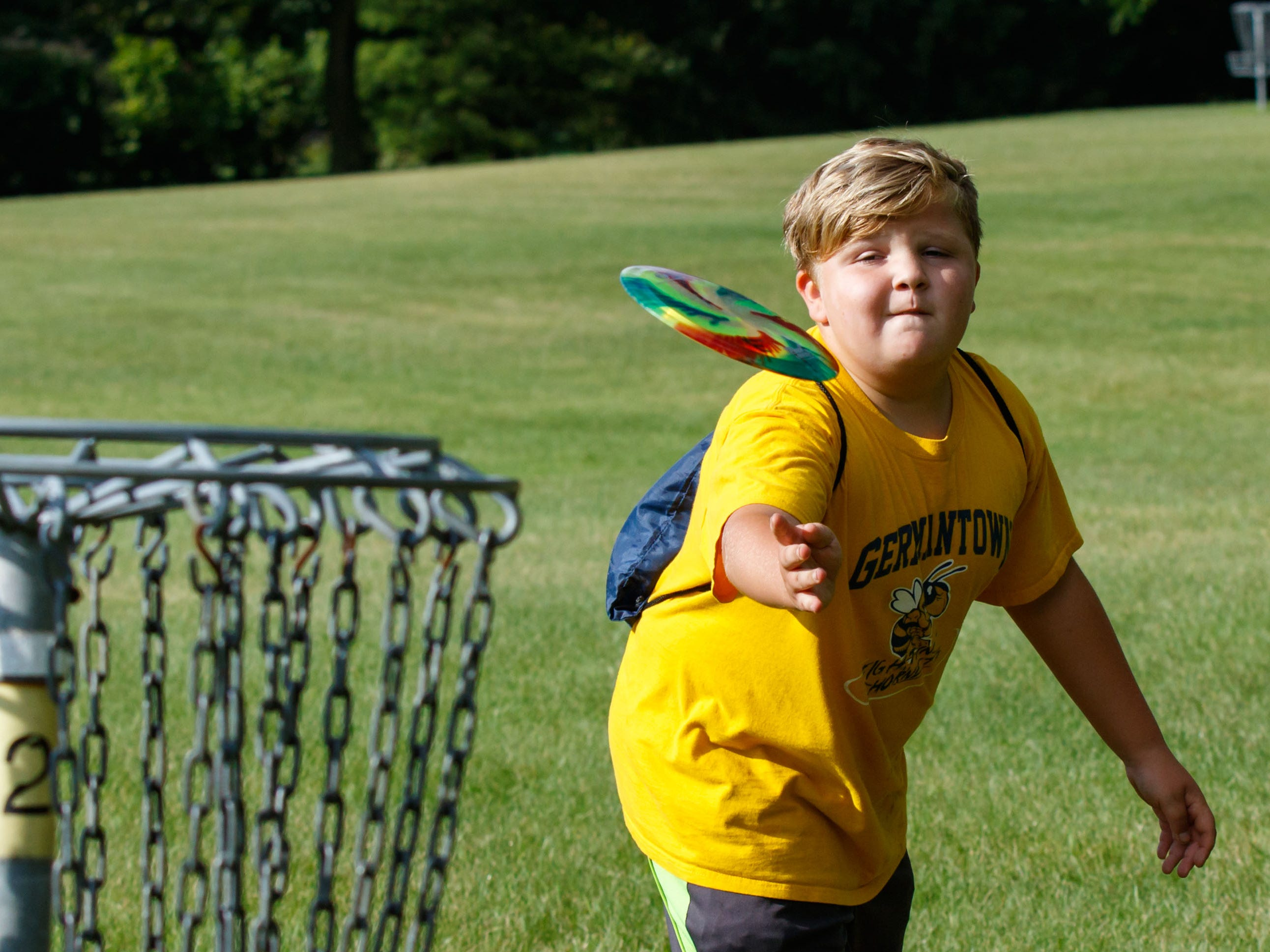 Evan Schmitt, 11, of Germantown, plays a round of disc golf during the Disc Golf Extravaganza event hosted by the Germantown Park & Recreation Department at Spassland Park in on Wednesday, August 1, 2018. The free event featured demonstrations and tips by professional disc golfers, games, concessions and more.