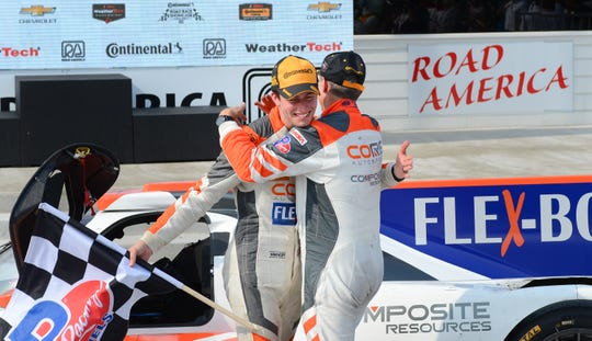 Colin Braun gets a hug from co-driver Jonathan Bennett after winning Road America's IMSA sports-car race in August.