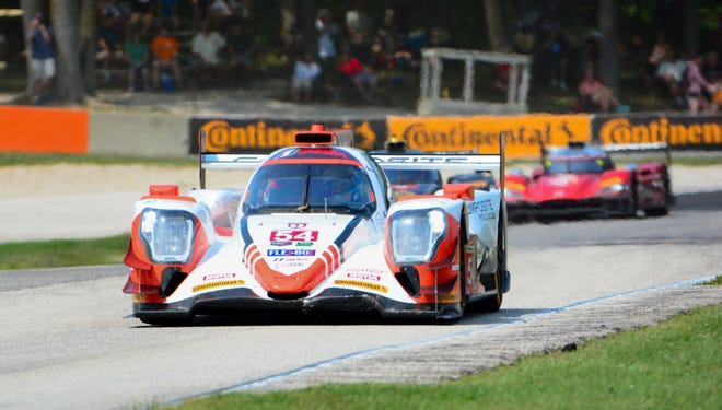 Colin Braun powers down the short straightaway between Turns 6 and 7 at Road America during the Continental Tire Road Race Showcase for the IMSA WeatherTech SportsCar Championship on Sunday, August 5, 2018, in Elkhart Lake, Wis. Braun and Jonathan Bennett won the overall title.