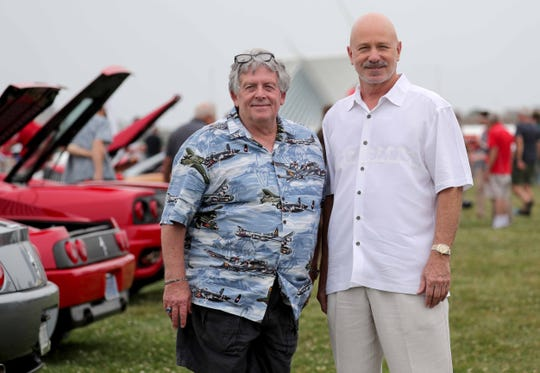 Skip Mueller (left) and Joseph L. Ford III  have sued take possession of a very rare $7 million 1938 French sports car that was stolen from Mueller's cousin in Milwaukee 2001 and is now in the possession of a wealthy collector who bought it through European brokers. The Wisconsin Supreme Court may decide who gets it. They're pictured at the 2018Milwaukee Concours d'Elegance at Veterans Park on Sunday, August 5, 2018.