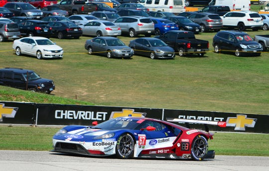 Richard Westbrook climbs the hill to Turn 6 during the Continental Tire Road Race Showcase on Sunday, August 5, 2018, at Road America in Elkhart Lake, Wis. Westbrook and Ryan Briscoe won the GT Le Mans class.