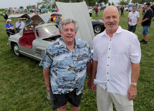 Skip Mueller, left, and Joseph L. Ford III  have sued to take possession of a very rare $7 million 1938 French sports car that was stolen from Mueller's cousin in Milwaukee in 2001 and is now in the possession of a wealthy collector who bought it through European brokers. The Wisconsin Supreme Court may decide who gets it. They're pictured at the 2018 Milwaukee Concours d'Elegance at Veterans Park on Sunday, August 5, 2018.