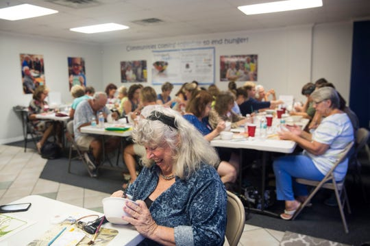 Margaret Brading paints a bowl during Empty Bowls Naples' monthly public painting party on Sunday, Aug. 5, 2018. Empty Bowls is an independent all-volunteer nonprofit organization celebrating its 13th year, with a mission to create awareness and raise funds to eliminate hunger one bowl at a time. Each bowl is made and fired by a local potter, while participants sign up in advance to attend a painting party to decorate a bowl. The Empty Bowls event held each January in Cambier Park supports a community effort to feed the nearly 40,000 people in Collier County who are food insecure.