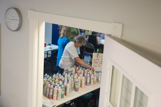 Barbara Wolfe prepares to hand out paint to participants during Empty Bowls Naples' monthly public painting party on Sunday, Aug. 5, 2018. Empty Bowls is an independent all-volunteer nonprofit organization celebrating its 13th year, with a mission to create awareness and raise funds to eliminate hunger one bowl at a time. Each bowl is made and fired by a local potter, while participants sign up in advance to attend a painting party to decorate a bowl. The Empty Bowls event held each January in Cambier Park supports a community effort to feed the nearly 40,000 people in Collier County who are food insecure.