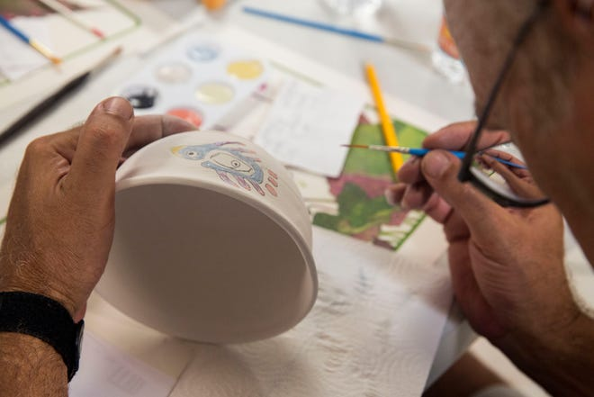 Ron Weilmuenster paints a bowl during Empty Bowls Naples' monthly public painting party on Sunday, Aug. 5, 2018. Empty Bowls is an independent all-volunteer nonprofit organization celebrating its 13th year, with a mission to create awareness and raise funds to eliminate hunger one bowl at a time. Each bowl is made and fired by a local potter, while participants sign up in advance to attend a painting party to decorate a bowl. The Empty Bowls event held each January in Cambier Park supports a community effort to feed the nearly 40,000 people in Collier County who are food insecure.