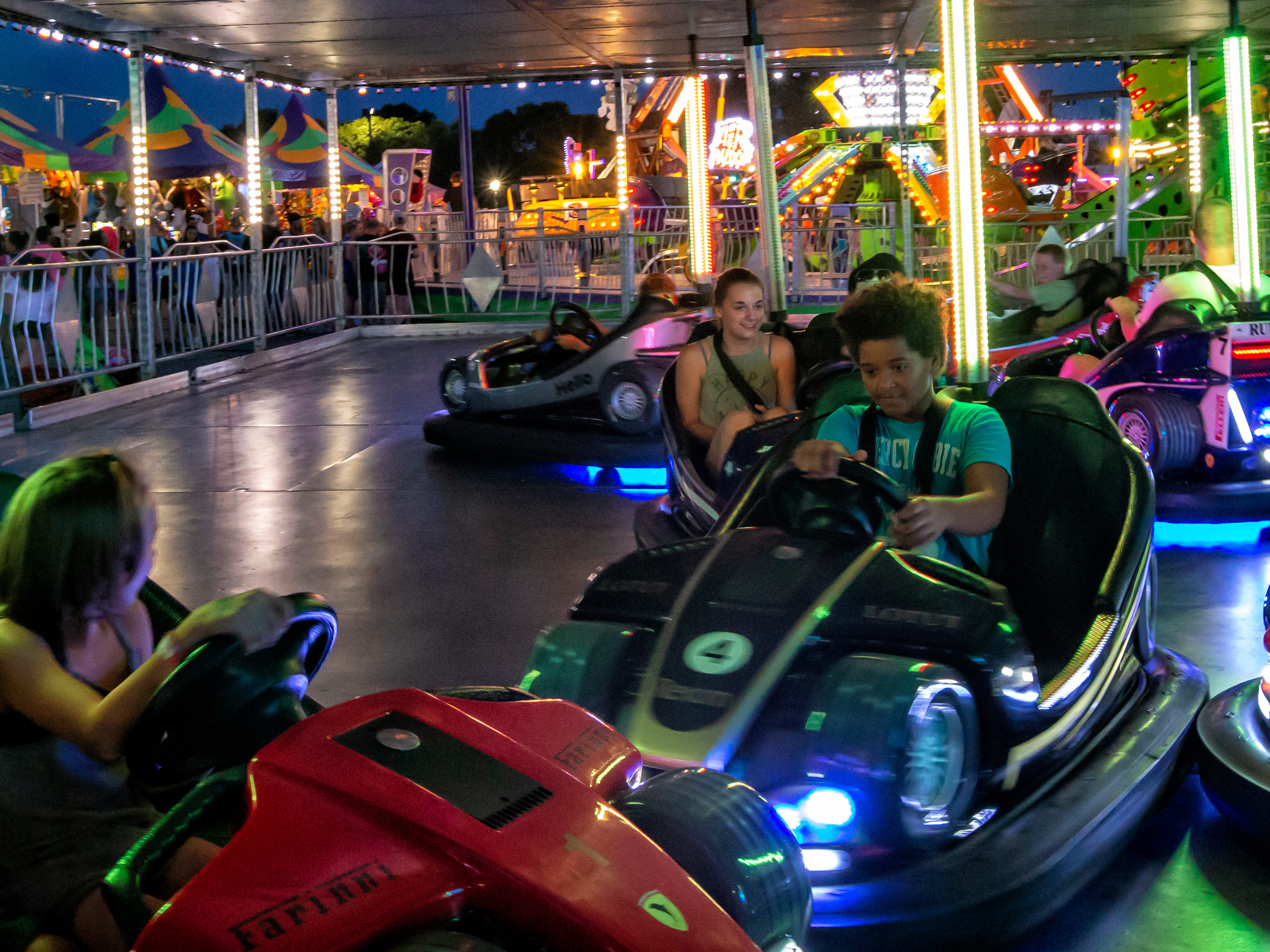 People ride the bumper cars during the Winnebago County Fair on Saturday, Aug. 4, 2018.