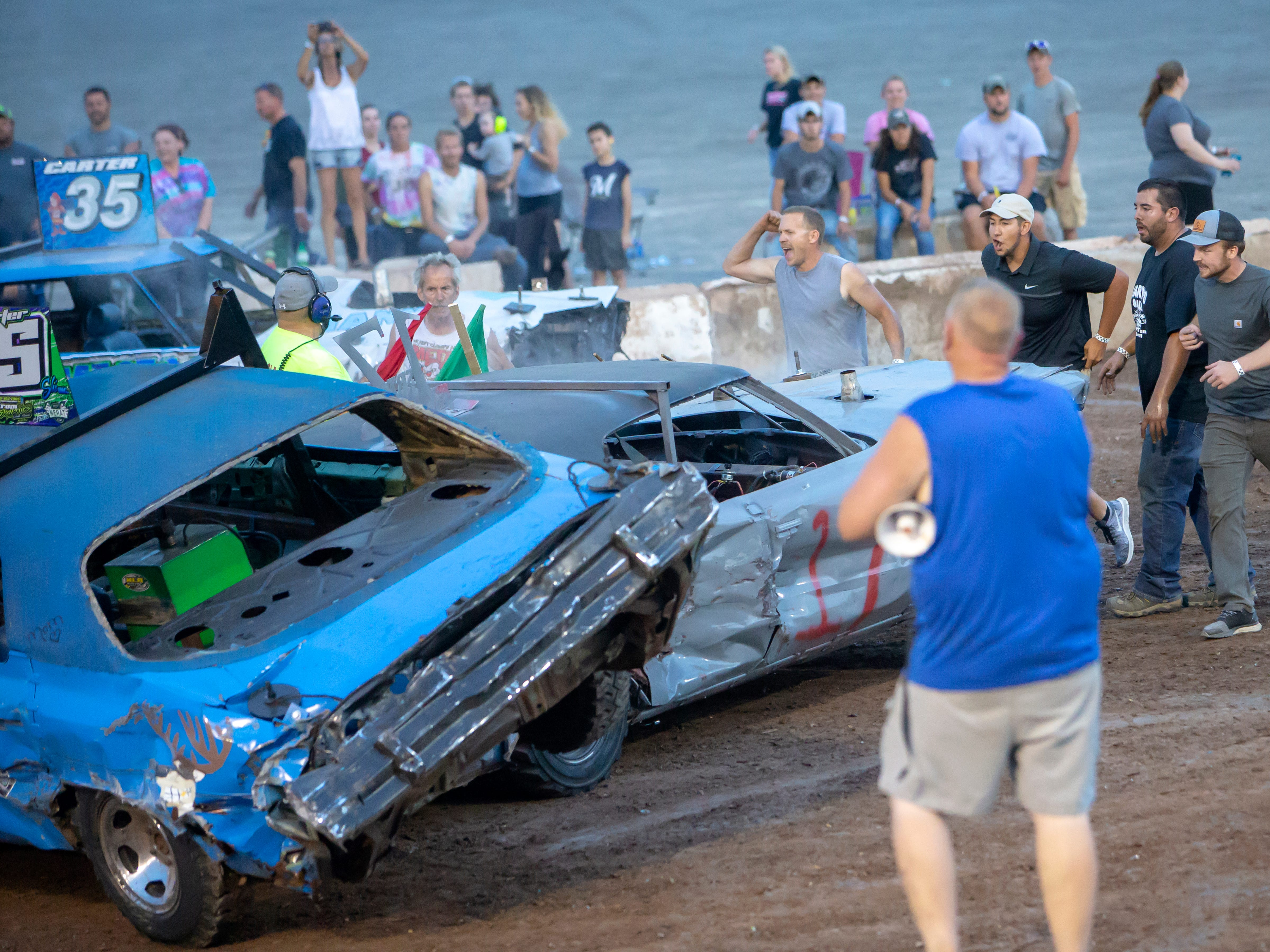 Drivers compete in the demolition derby during the Winnebago County Fair on Saturday, Aug. 4, 2018.