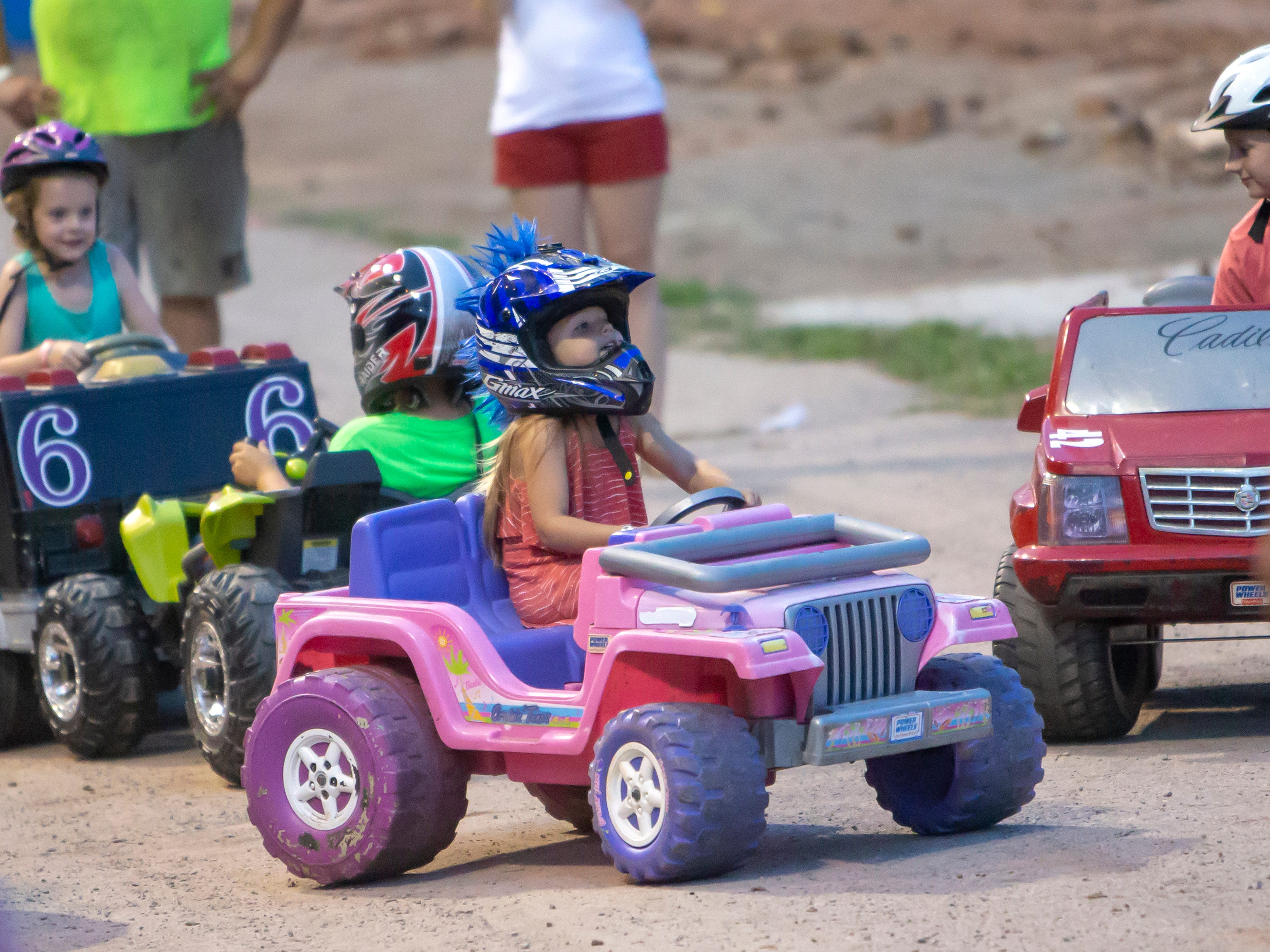 Children drive toy cars for their own demolition derby during the Winnebago County Fair on Saturday, Aug. 4, 2018.