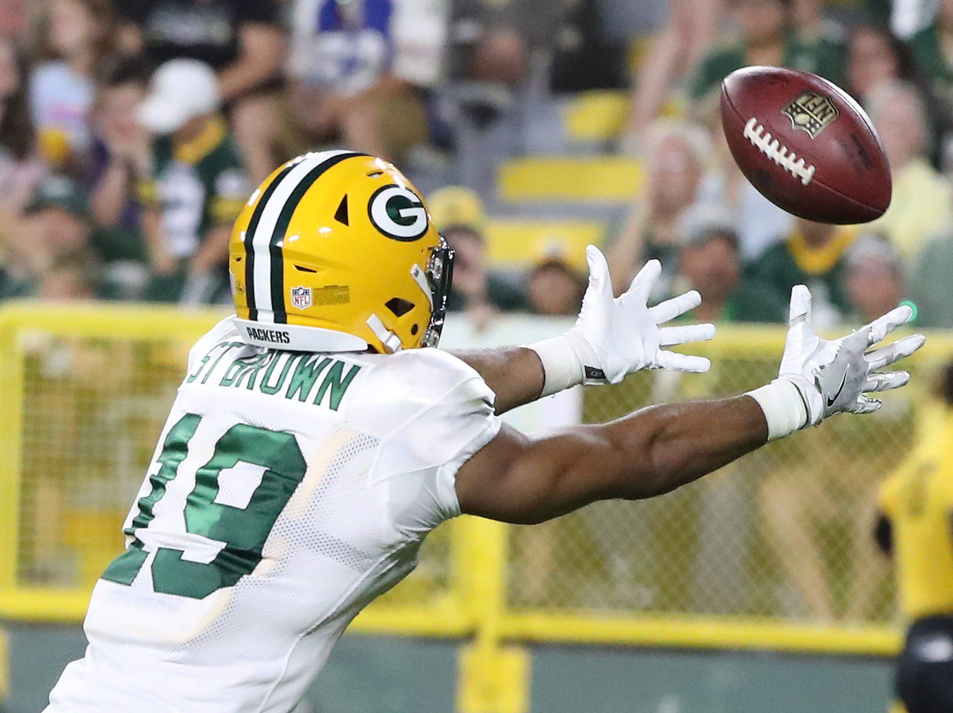 Green Bay Packers wide receiver Equanimeous St. Brown (19) stretched for a pass during Green Bay Packers Family Night  Saturday, August 4, 2018 at Lambeau Field in Green Bay, Wis.,