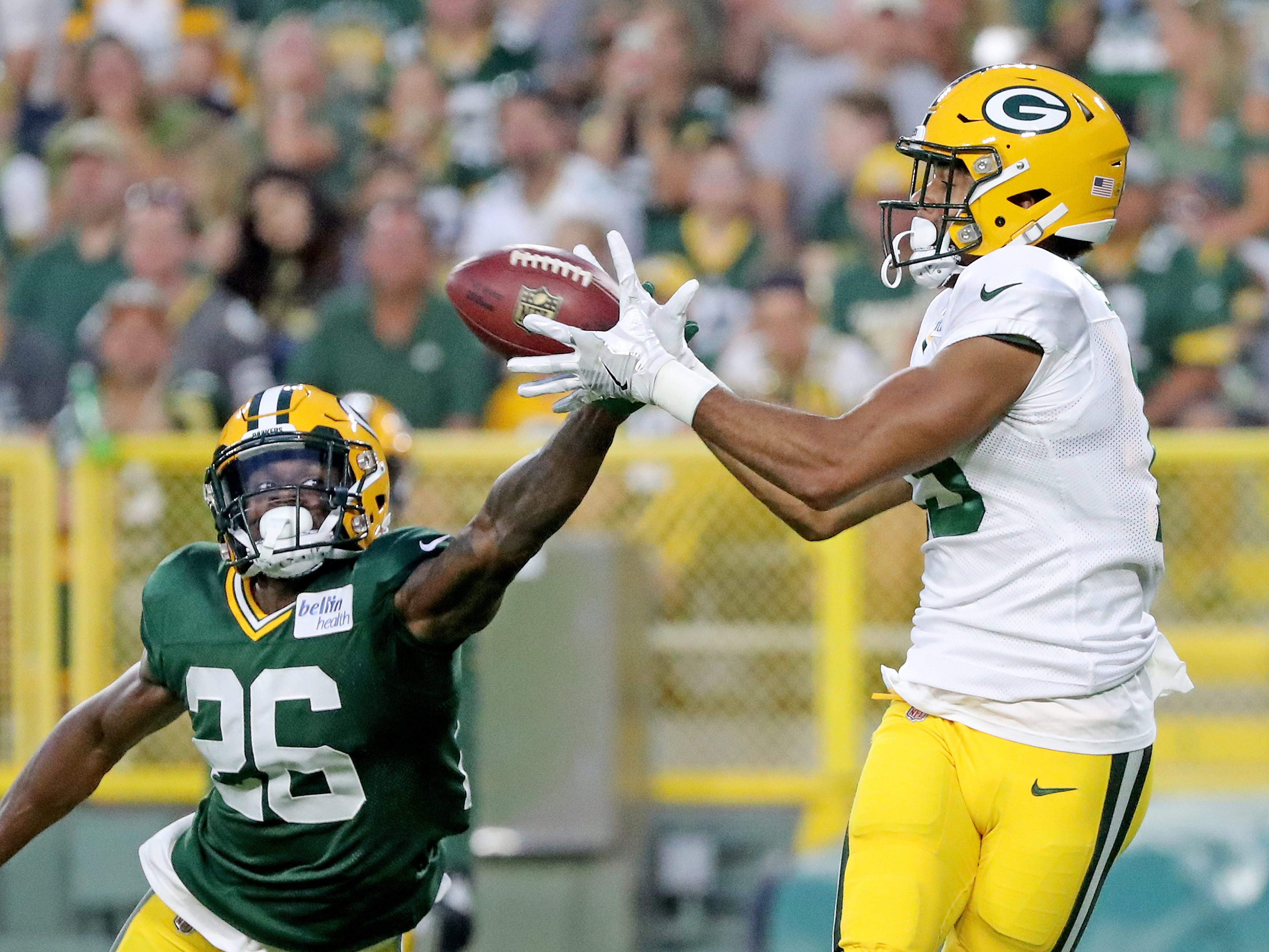 Green Bay Packers wide receiver Equanimeous St. Brown (19) catches a touchdown against cornerback Herb Waters (26) during Green Bay Packers Family Night  Saturday, August 4, 2018 at Lambeau Field in Green Bay, Wis.,