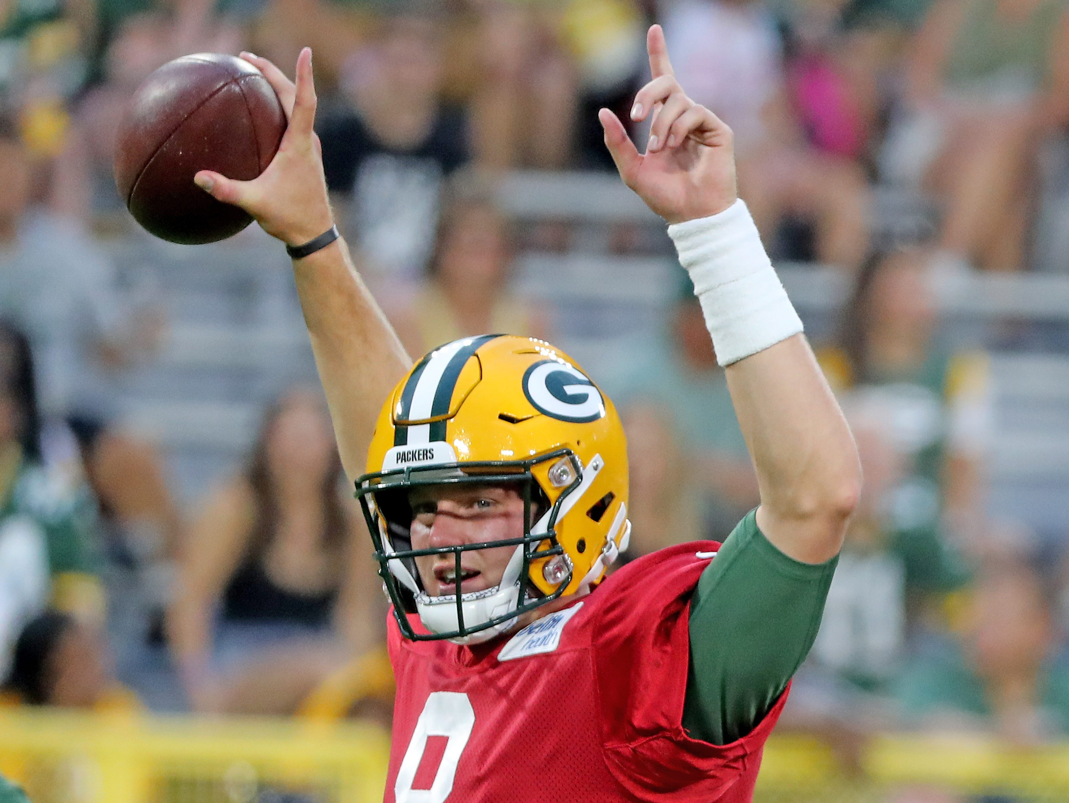 Green Bay Packers quarterback Tim Boyle (8) raises his arms in victory during a drill lduring Green Bay Packers Family Night  Saturday, August 4, 2018 at Lambeau Field in Green Bay, Wis.,