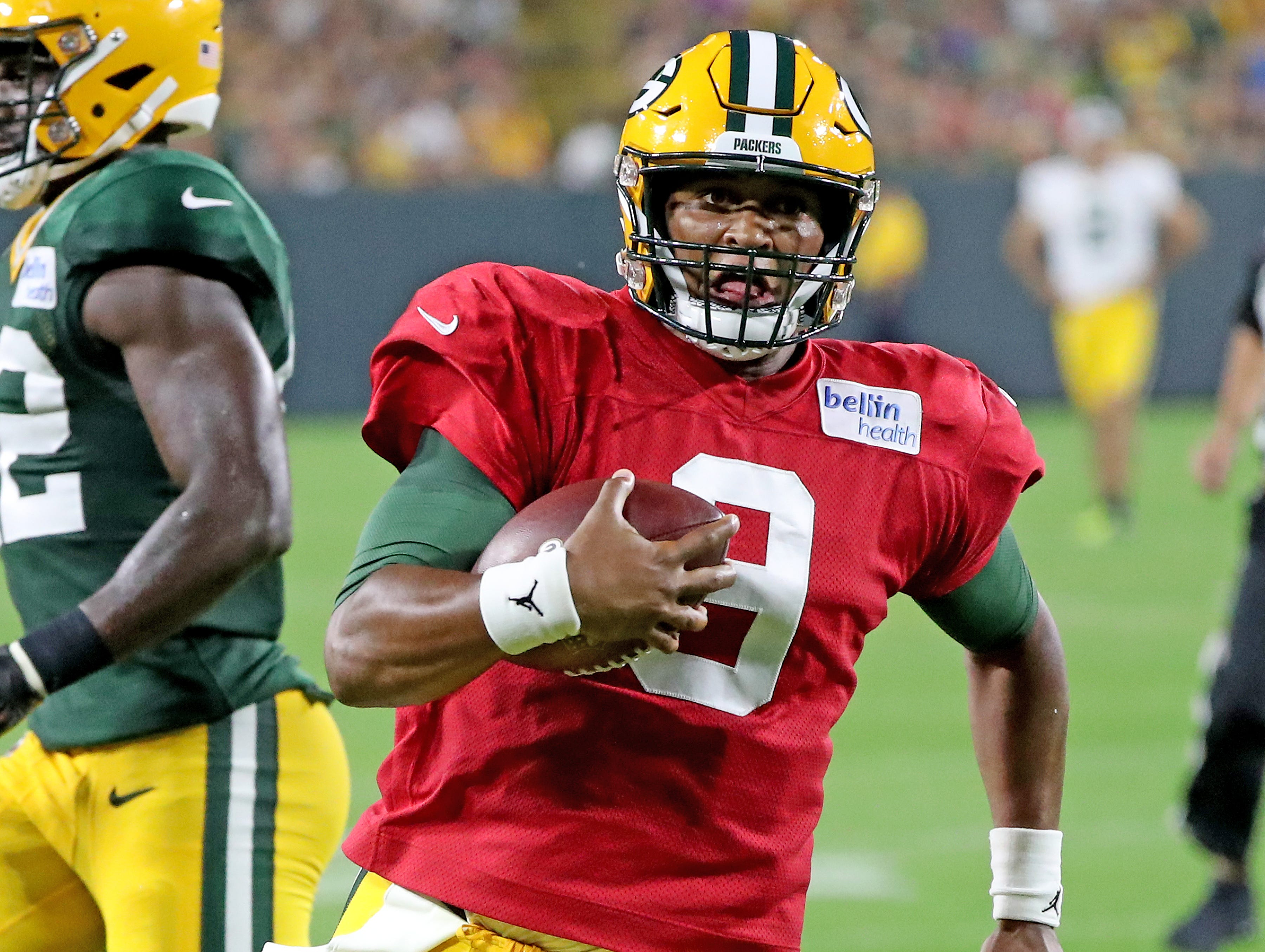 Green Bay Packers quarterback DeShone Kizer (9) runs to the goal line during Green Bay Packers Family Night  Saturday, August 4, 2018 at Lambeau Field in Green Bay, Wis.,