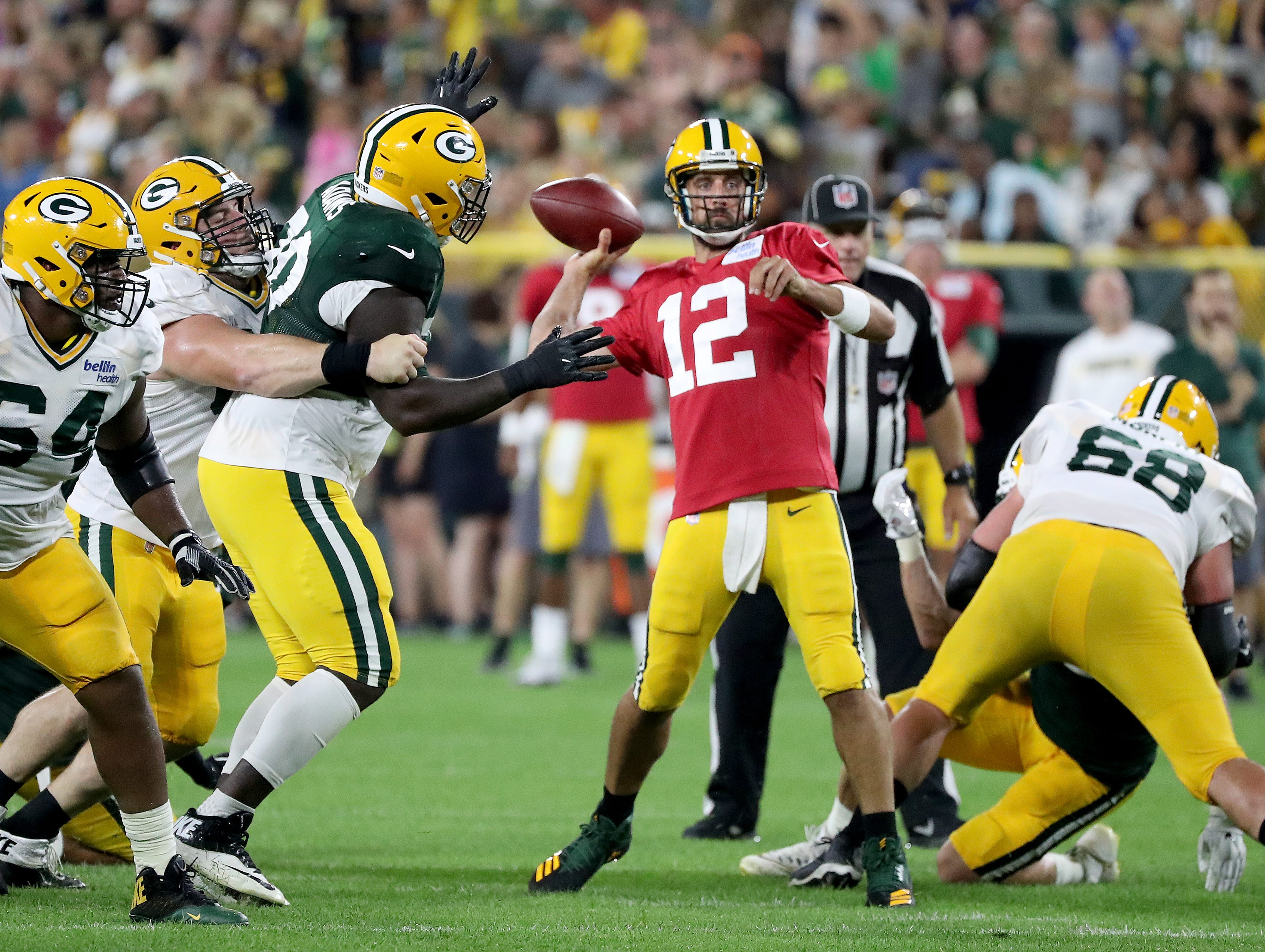 Green Bay Packers quarterback Aaron Rodgers (12) throws long from the pocket during Green Bay Packers Family Night  Saturday, August 4, 2018 at Lambeau Field in Green Bay, Wis.,