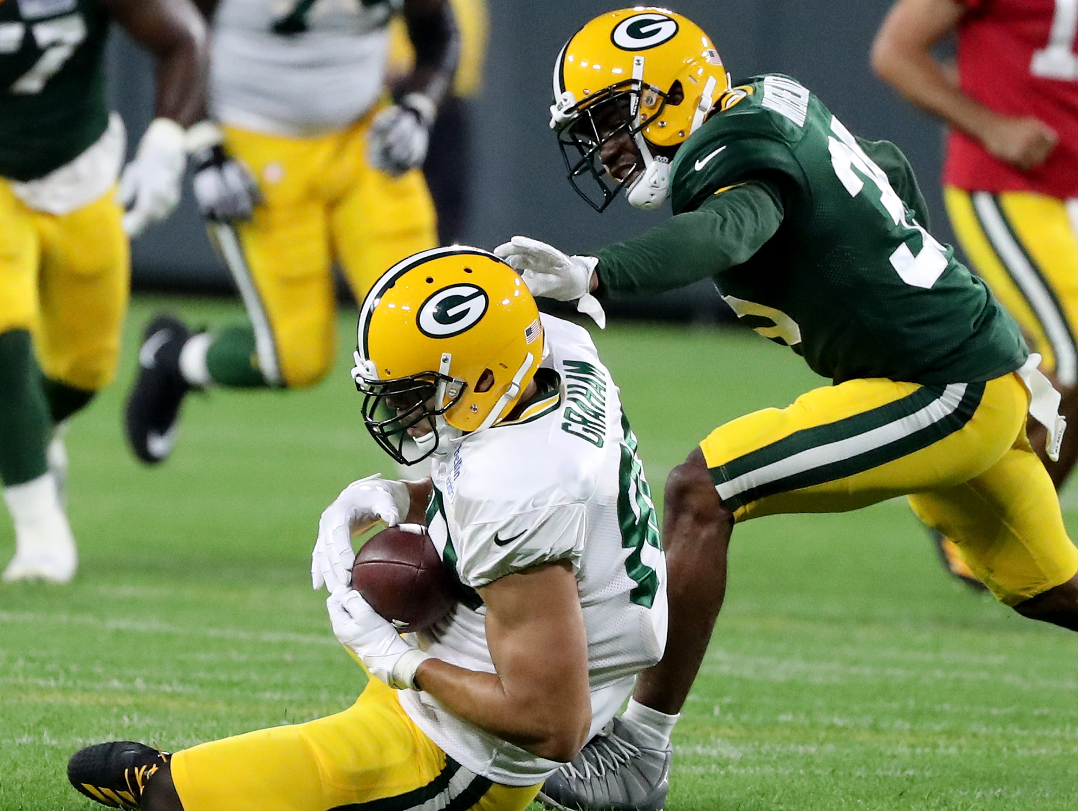 Green Bay Packers tight end Jimmy Graham (80) makes a catch during Green Bay Packers Family Night  Saturday, August 4, 2018 at Lambeau Field in Green Bay, Wis.,