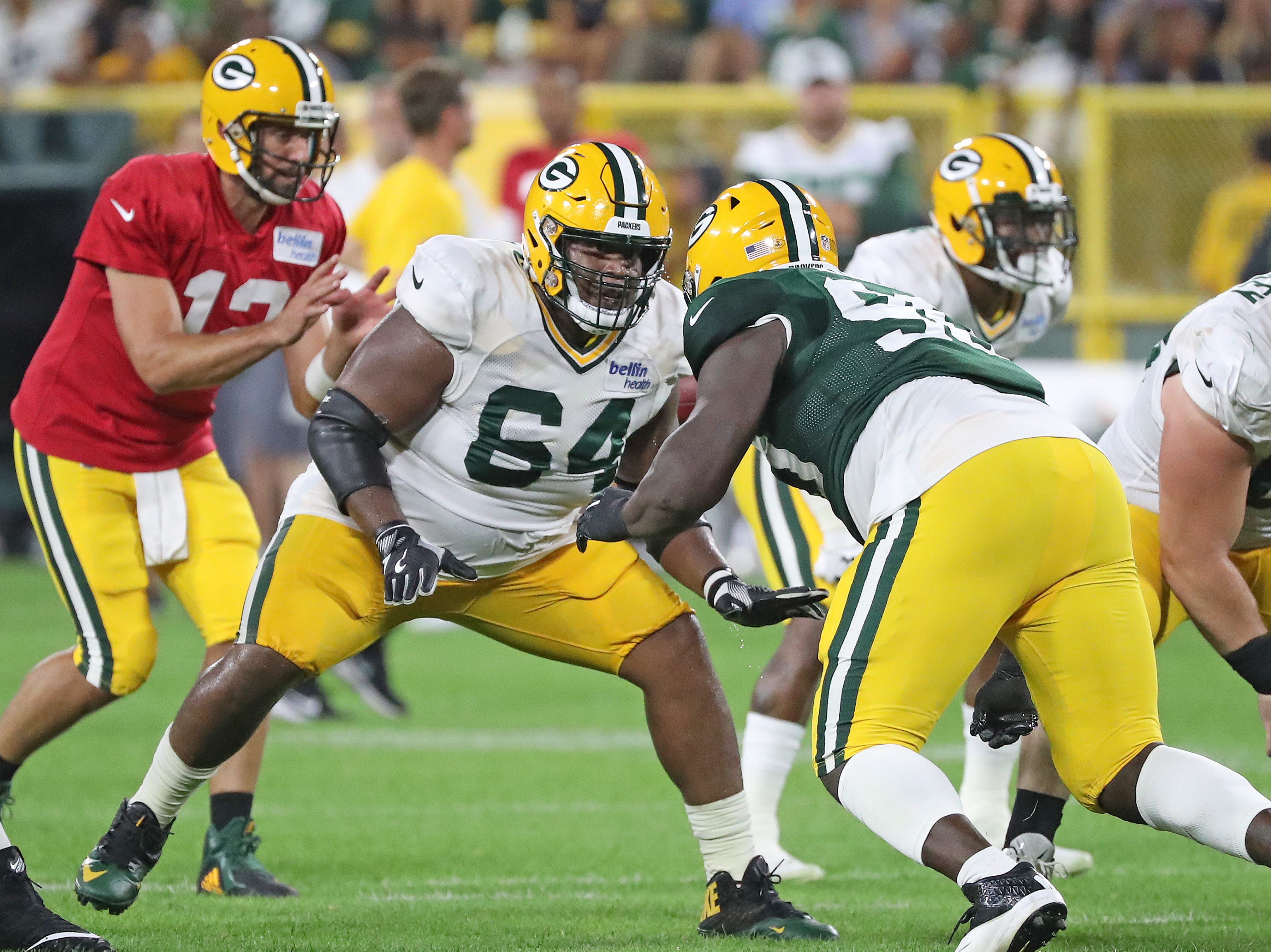 Green Bay Packers offensive guard Justin McCray (64) blocks defensive tackle Montravius Adams (90) during Green Bay Packers Family Night  Saturday, August 4, 2018 at Lambeau Field in Green Bay, Wis.,