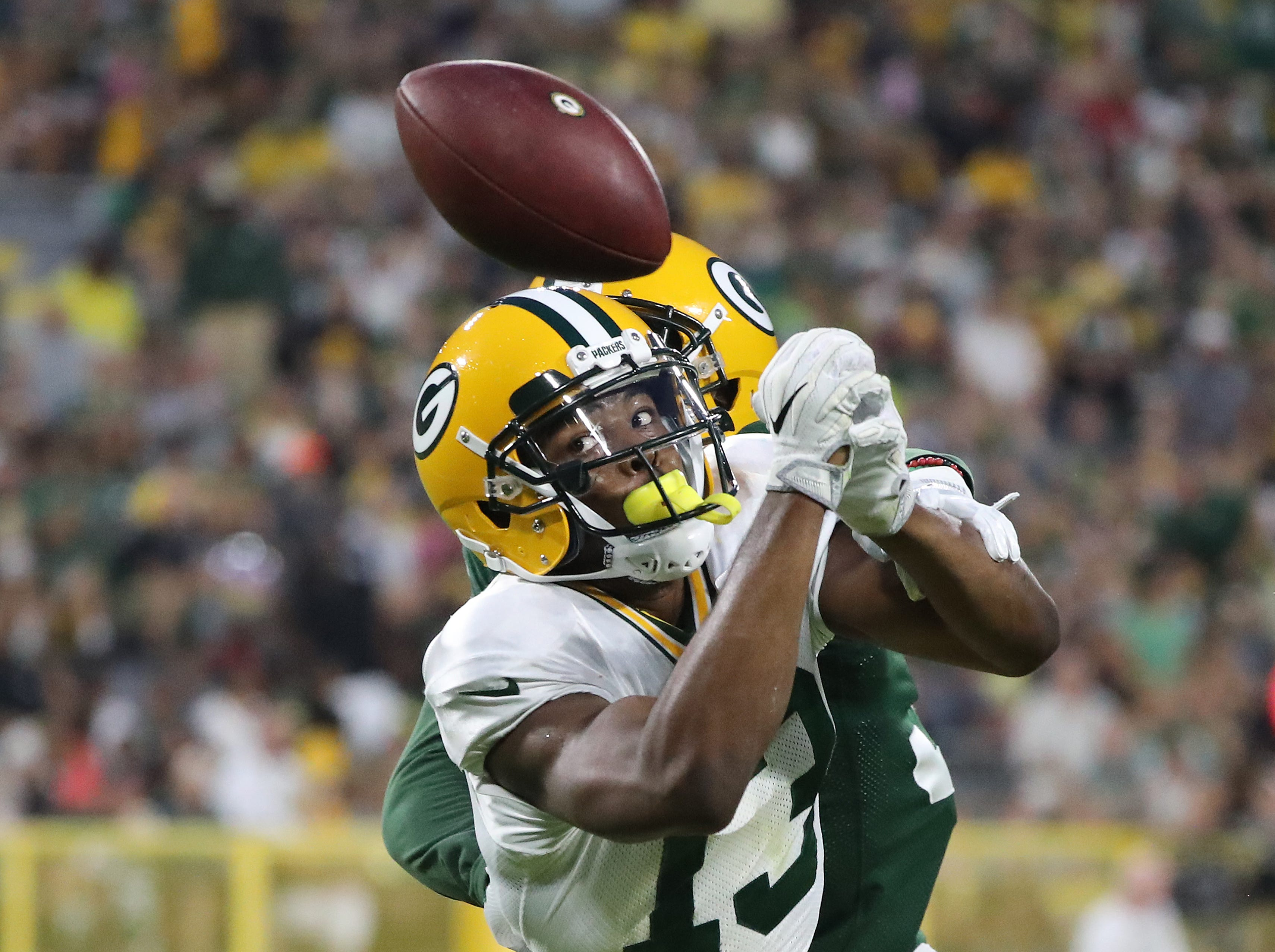Receiver Adonis Jennings (13) can't quite make a catch during Green Bay Packers Family Night  Saturday, August 4, 2018 at Lambeau Field in Green Bay, Wis.,