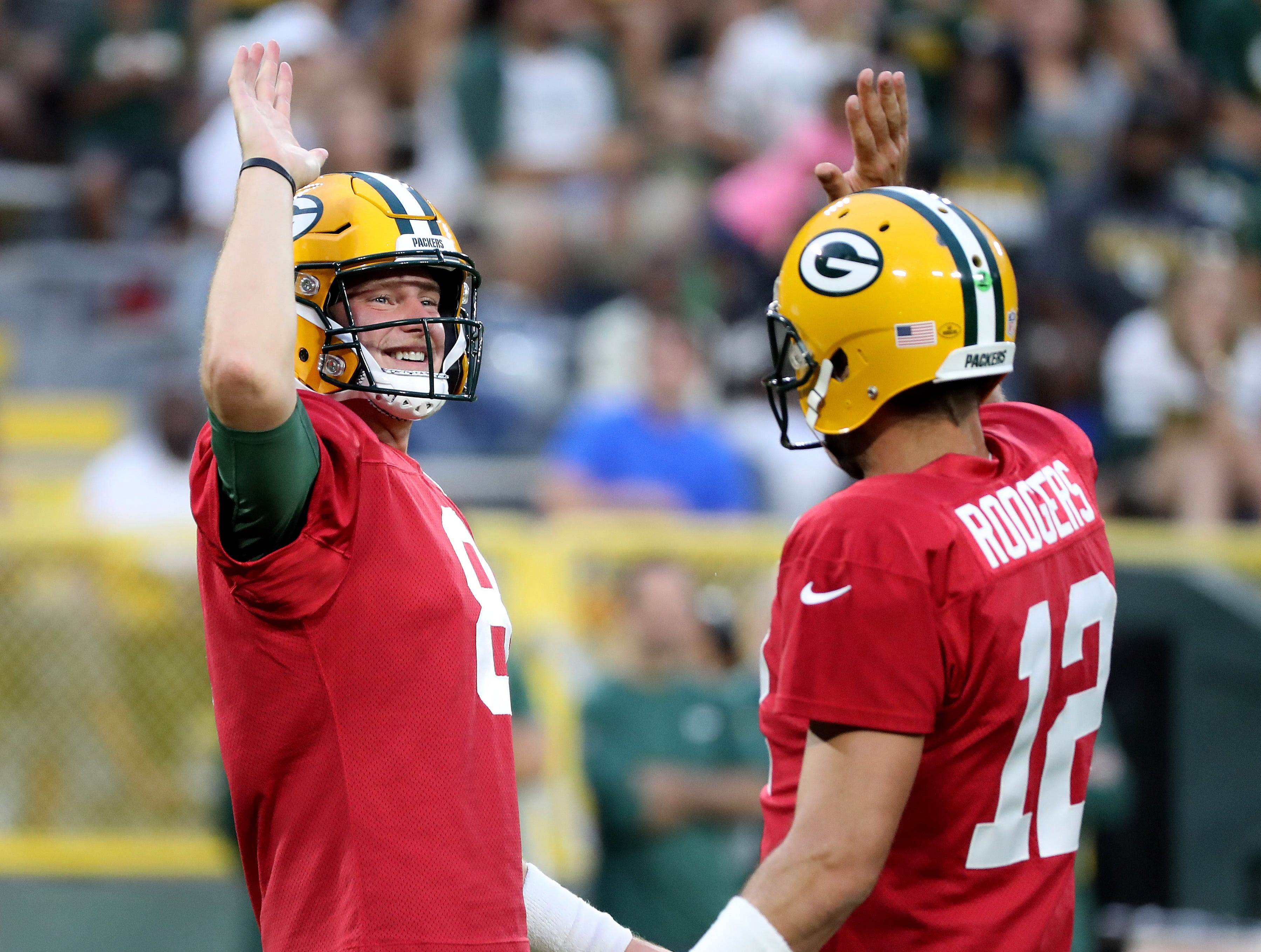 Green Bay Packers quarterback Tim Boyle (8) high fives with quarterback Aaron Rodgers (12) during Green Bay Packers Family Night  Saturday, August 4, 2018 at Lambeau Field in Green Bay, Wis.,