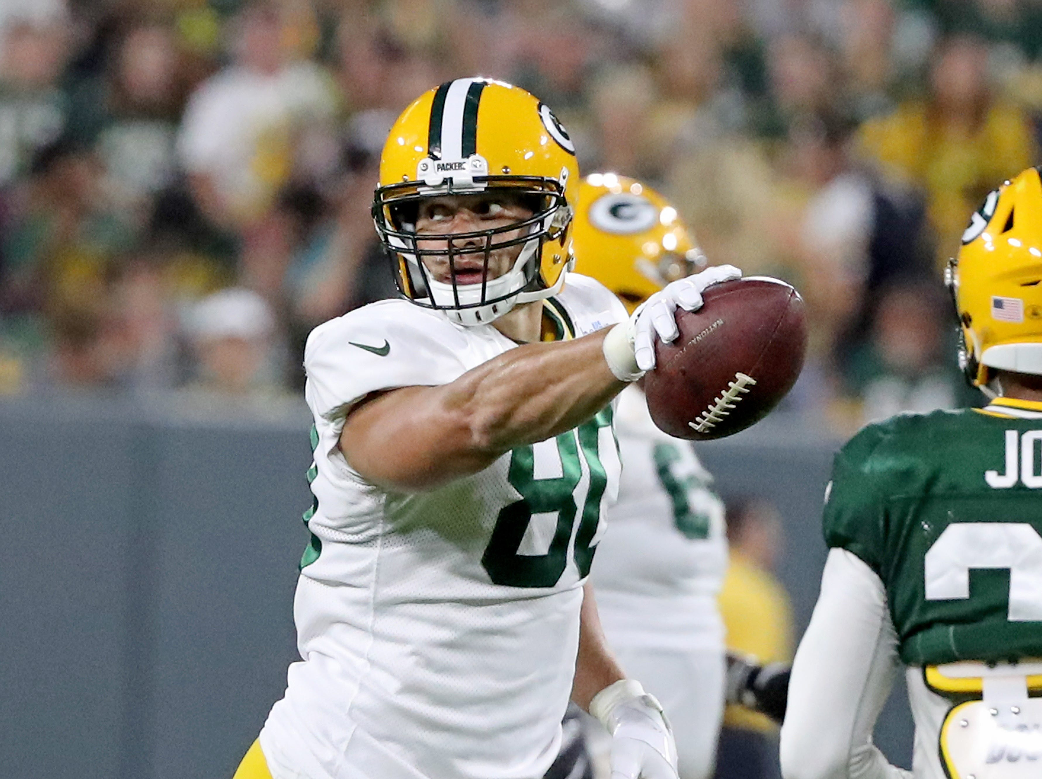 Green Bay Packers tight end Jimmy Graham (80) signals first down during Green Bay Packers Family Night  Saturday, August 4, 2018 at Lambeau Field in Green Bay, Wis.,