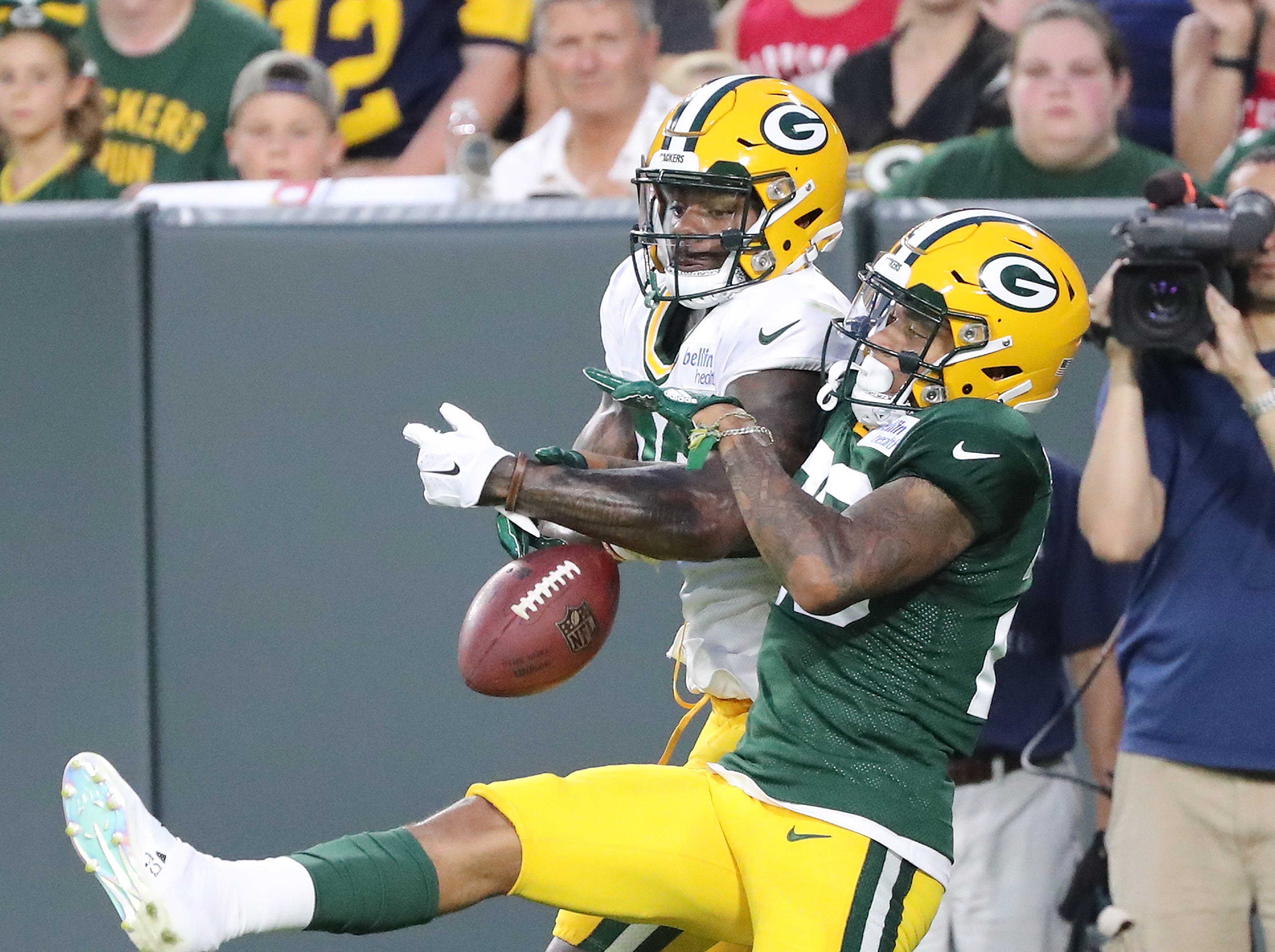 Green Bay Packers cornerback Jaire Alexander (23) breaks up a pass to wide receiver J'Mon Moore (82) during Green Bay Packers Family Night  Saturday, August 4, 2018 at Lambeau Field in Green Bay, Wis.,