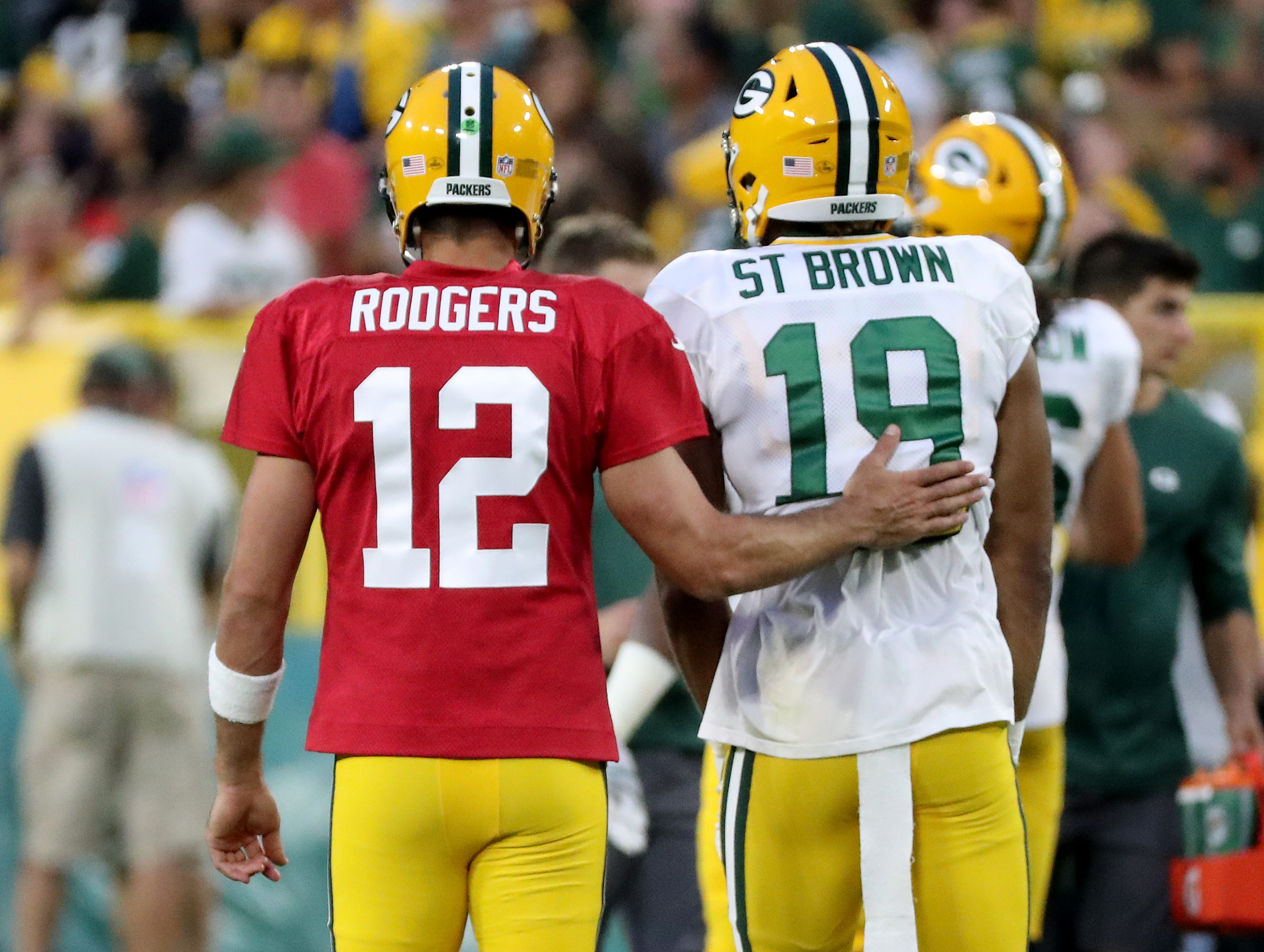 Green Bay Packers quarterback Aaron Rodgers (12) consoles wide receiver Equanimeous St. Brown (19) after he dropped a pass during Green Bay Packers Family Night  Saturday, August 4, 2018 at Lambeau Field in Green Bay, Wis.,