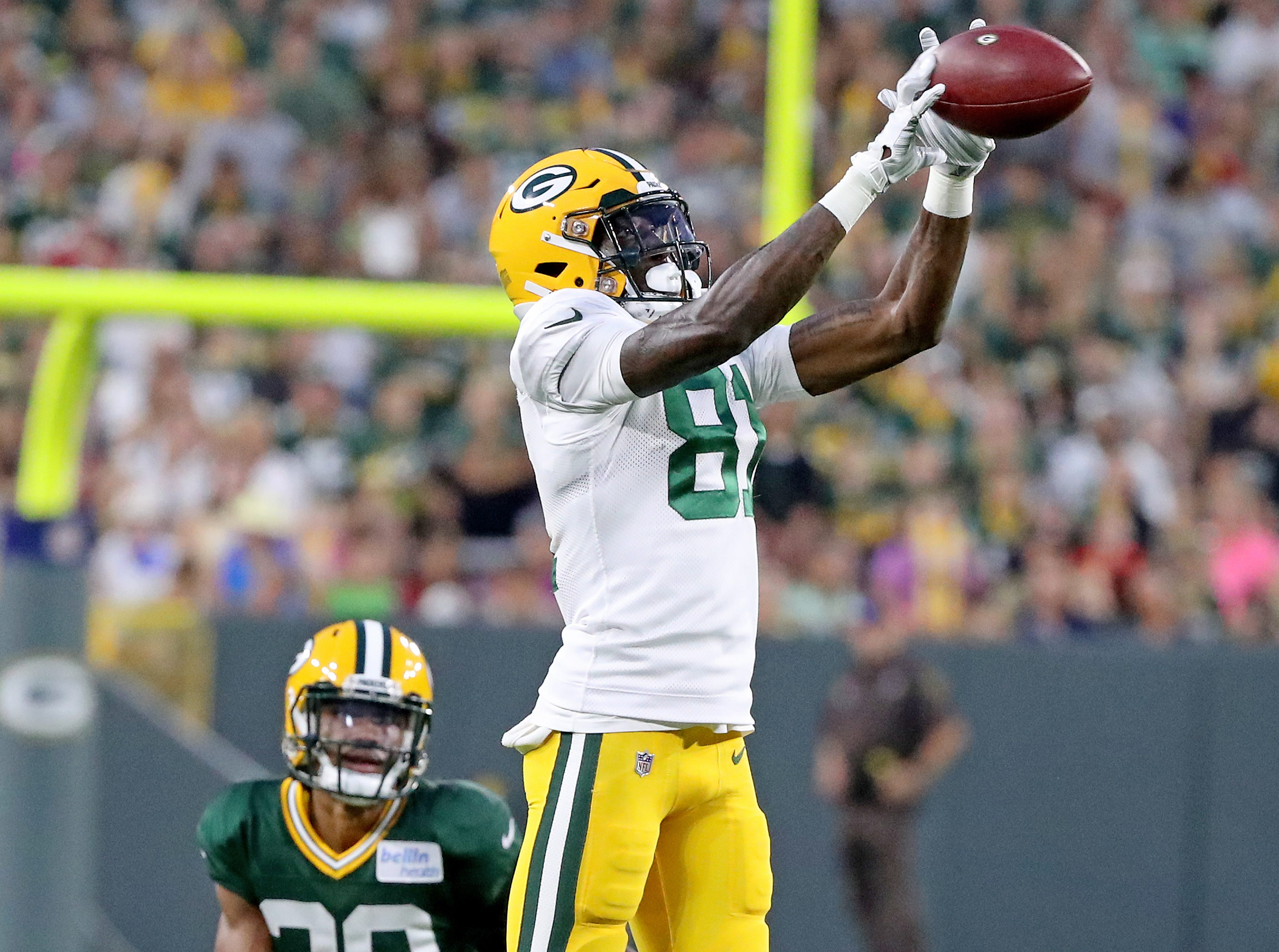 Green Bay Packers wide receiver Geronimo Allison (81) makes leaping catch during Green Bay Packers Family Night  Saturday, August 4, 2018 at Lambeau Field in Green Bay, Wis.,