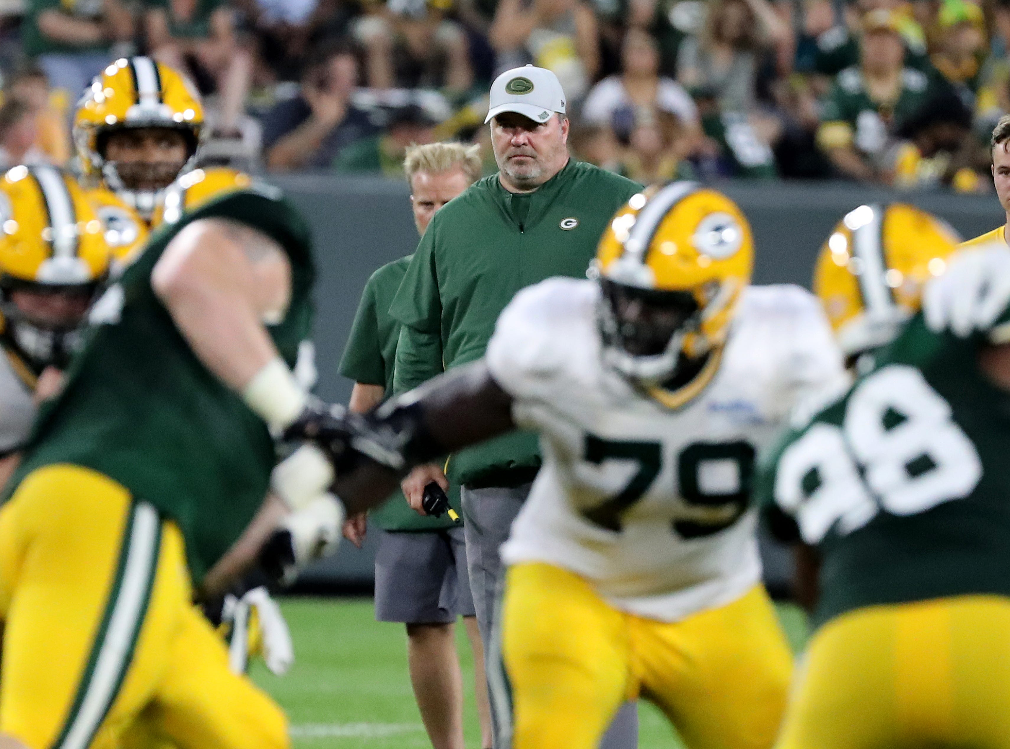 Head coach Mike McCarthy watches a play during Green Bay Packers Family Night  Saturday, August 4, 2018 at Lambeau Field in Green Bay, Wis.,
