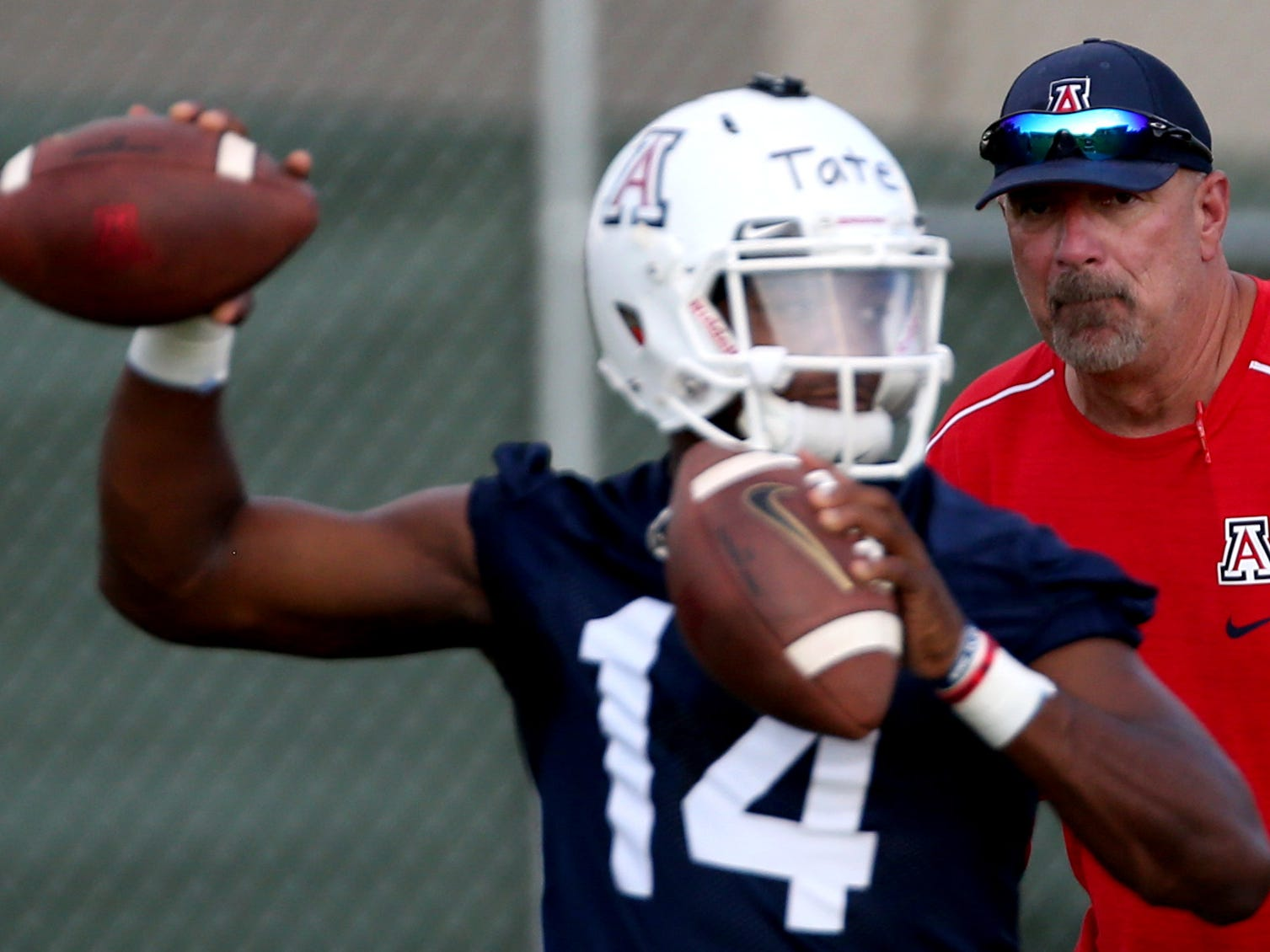 Offensive coordinator Noel Mazzone keeps a close eye on quarterback Khalil Tate on day two of pre-season practice for the University of Arizona, Friday, August 4, 2018, Tucson, Ariz.
