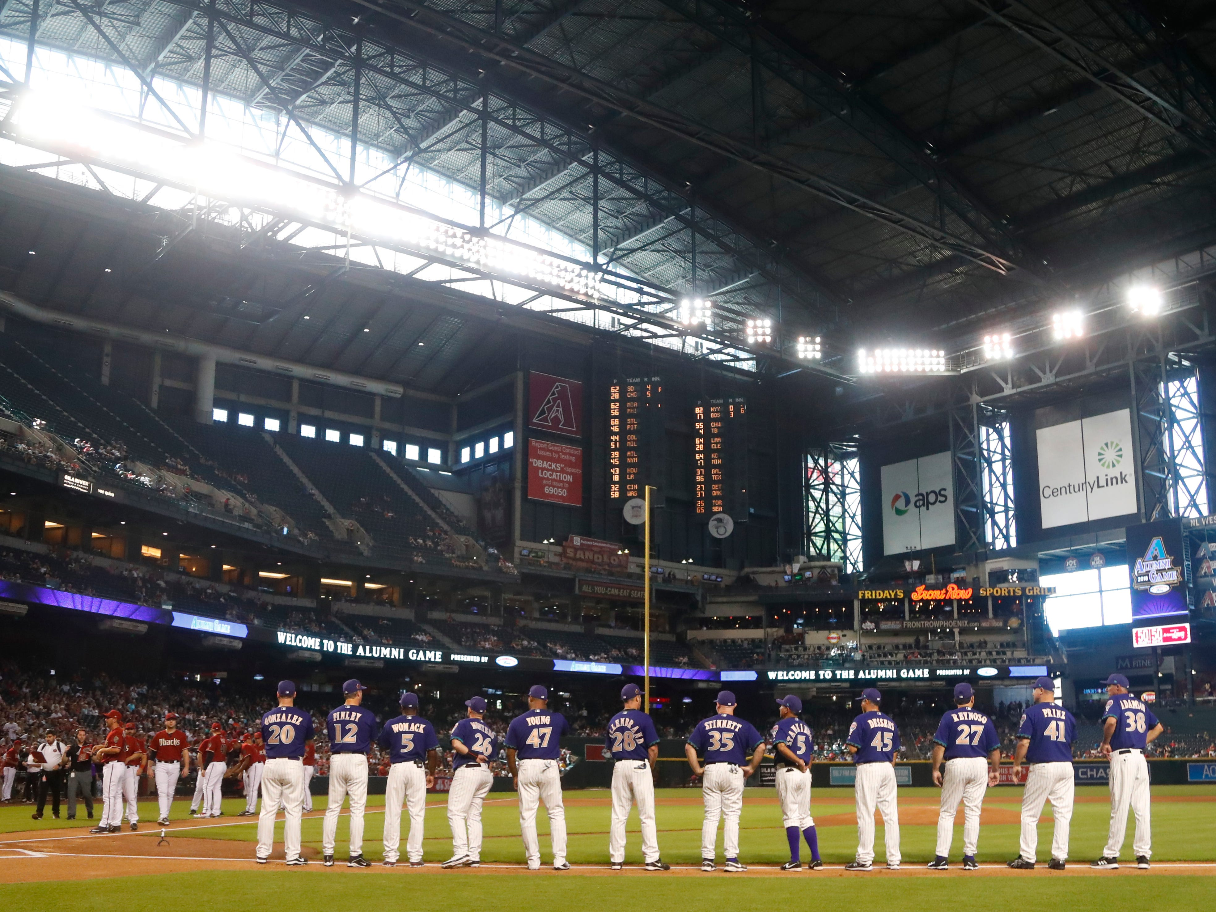 Diamondbacks Purple and Red team take the field prior to the Generations Diamomdbacks Alumni game at Chase Field in Phoenix, Ariz. on Aug. 4, 2018.