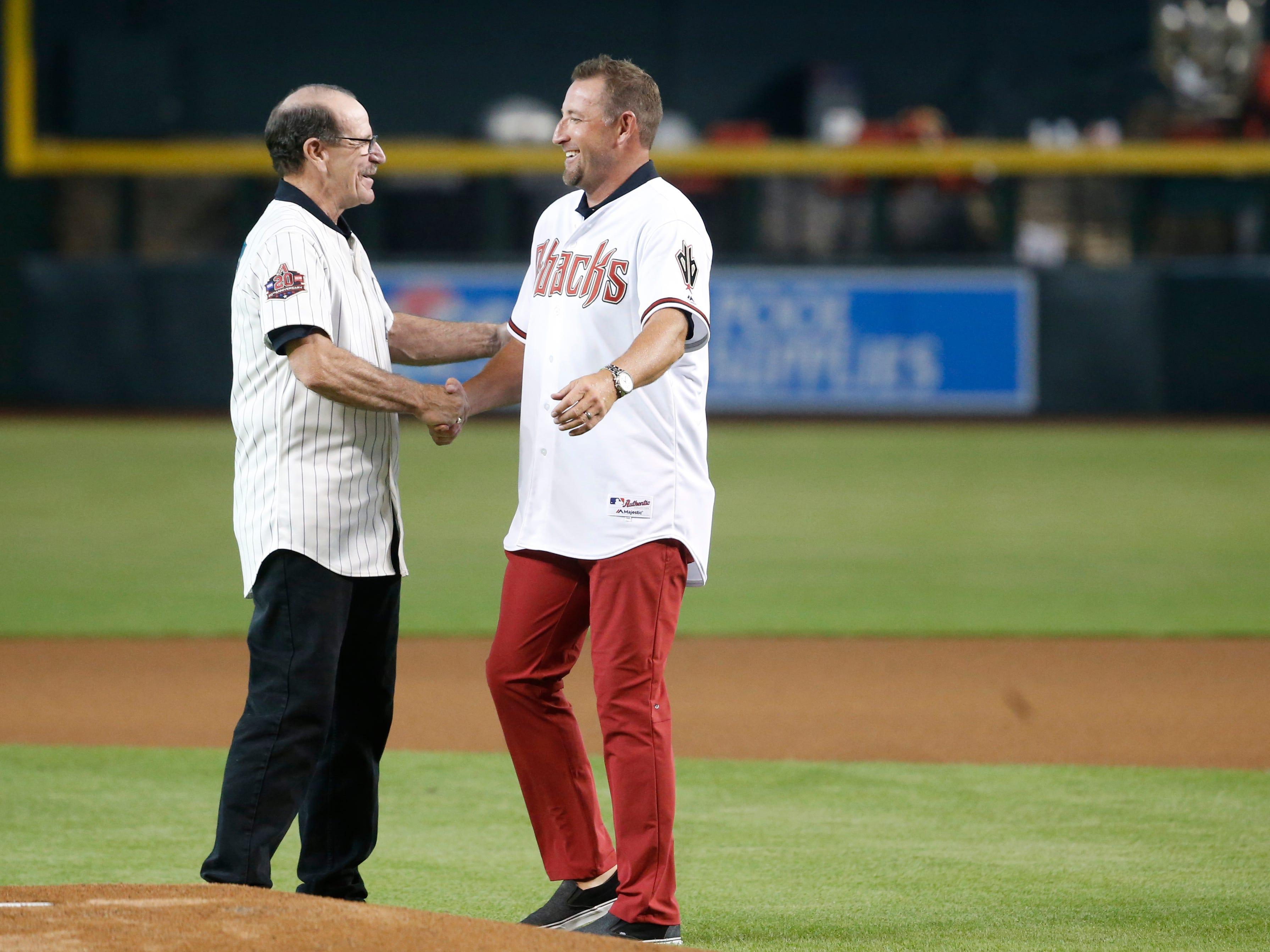 Former Diamondbacks manager Bob Brenly greets pitcher Brandon Webb, both chosen for the Diamondbacks 20th Anniversary team prior to a Diamondbacks game at Chase Field in Phoenix, Ariz. on Aug. 4, 2018.