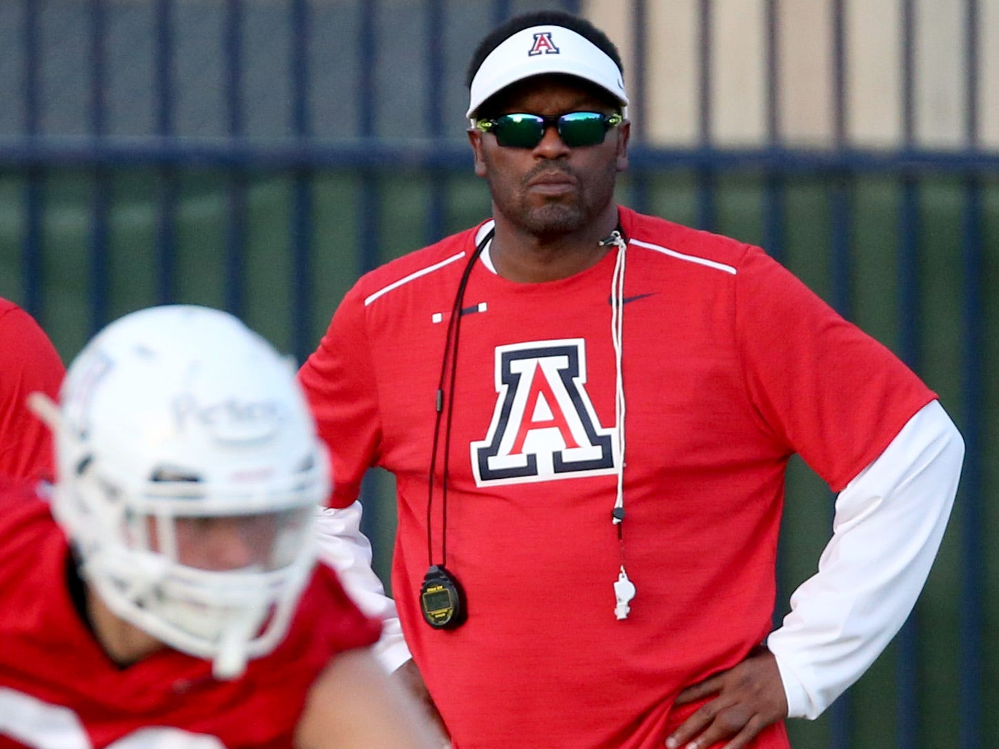 Head coach Kevin Sumlin watches the Wildcats run through drills on day two of pre-season practice for the University of Arizona, Friday, August 4, 2018, Tucson, Ariz.