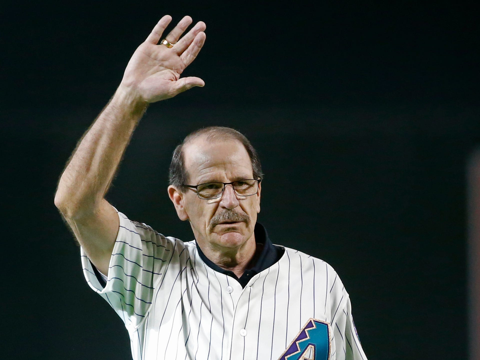 Former Diamondbacks manager Bob Brenly waves to fans during a ceremony some of the best players and managers of the past 20 years before a Diamondbacks game at Chase Field in Phoenix, Ariz. on Aug. 4, 2018.