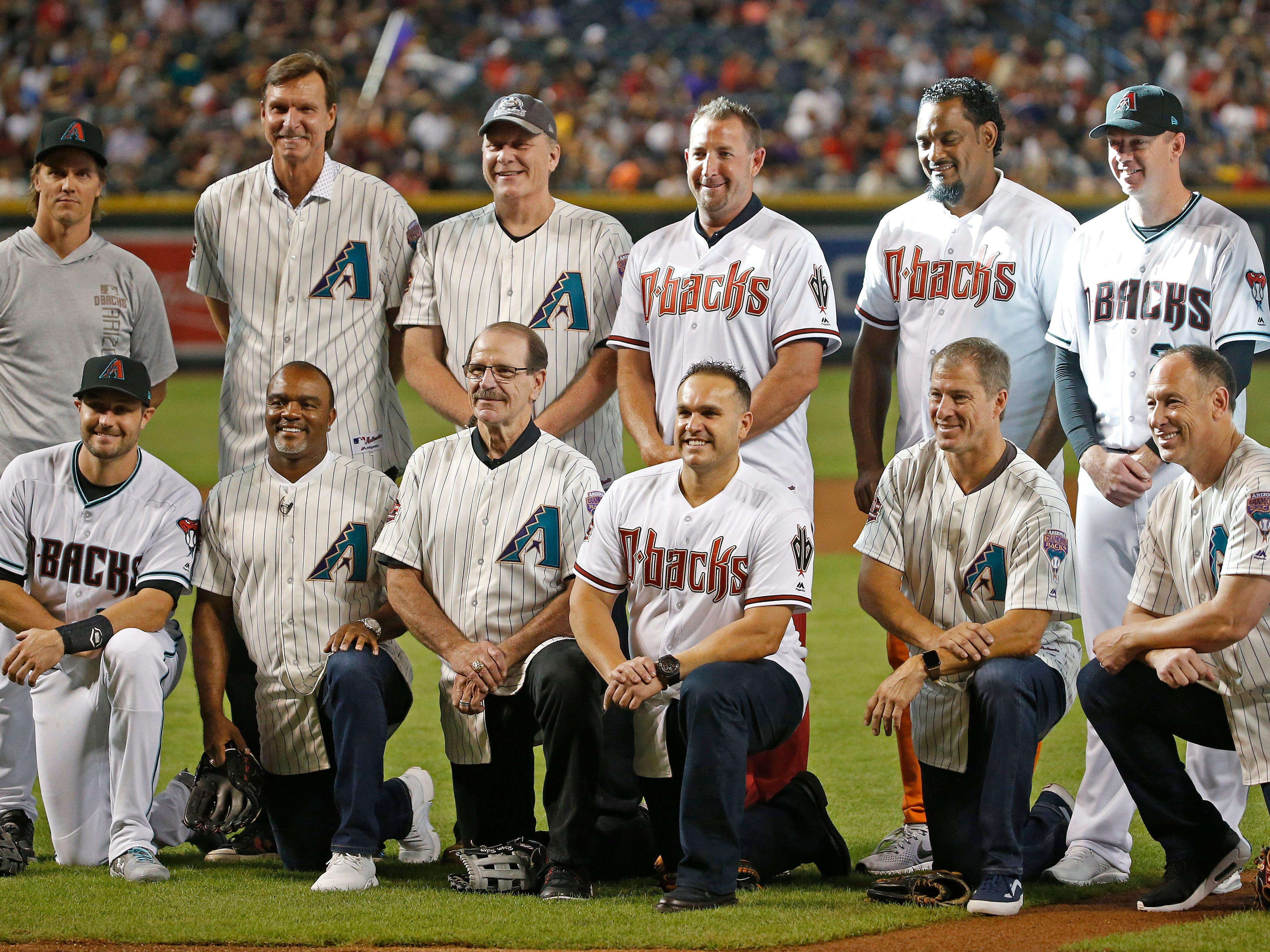The Diamondbacks 20th Anniversary team members line up on the field after a ceremony and before a Diamondbacks game at Chase Field in Phoenix, Ariz. on Aug. 4, 2018.