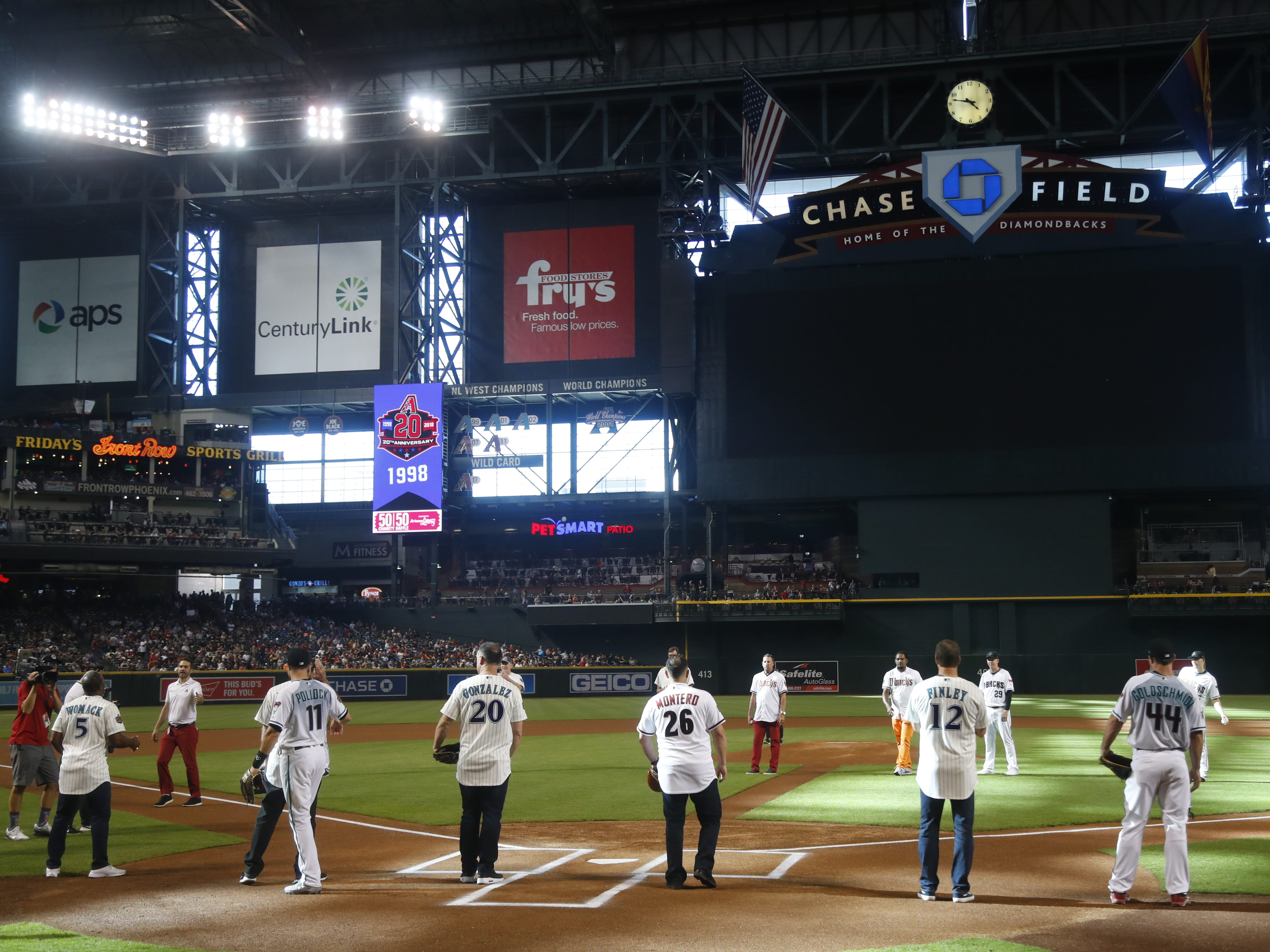 Former Diamondbacks players line up for the ceremonial first pitch before a Diamondbacks game at Chase Field in Phoenix, Ariz. on Aug. 4, 2018.