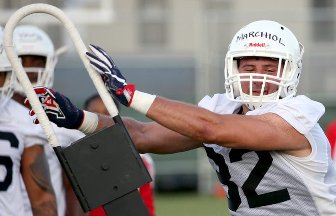 Linebacker Santino Marchiol shoves his way around a blocking sled on day two of pre-season practice for the University of Arizona, Friday, August 4, 2018, Tucson, Ariz.