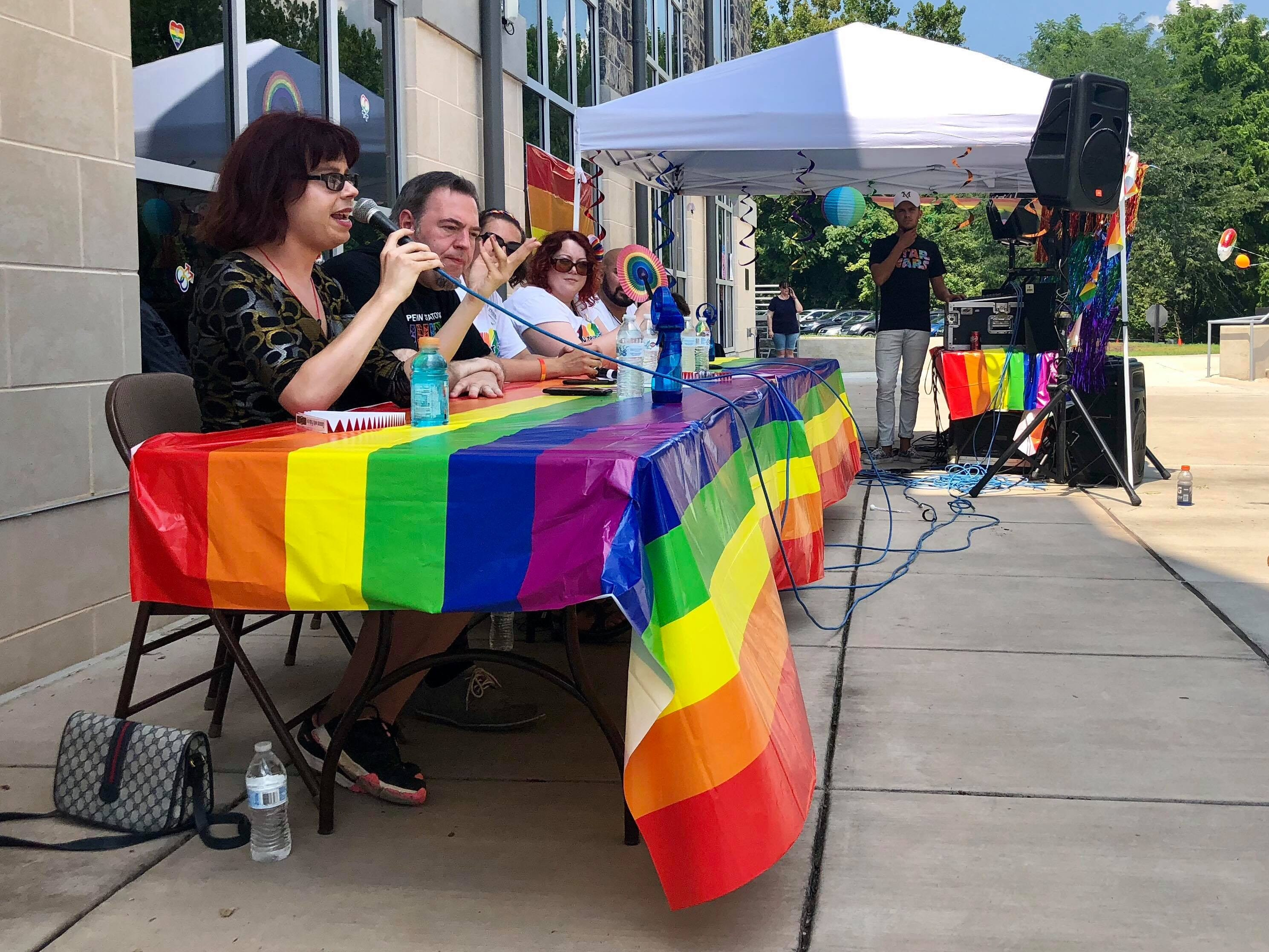 "Speakers talk to the crowd at the ""Coming Out"" panel discussion during Franklin County's first Pride festival the afternoon of Sunday, Aug. 5, 2018 at Wilson College in Chambersburg."