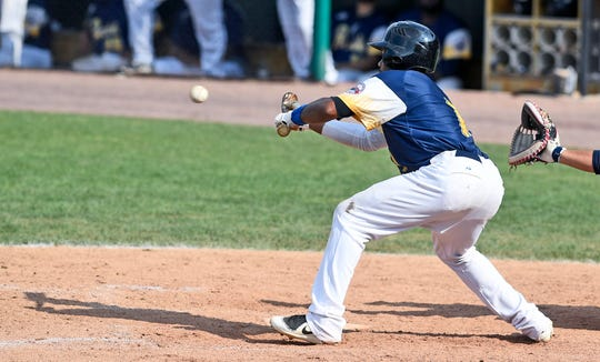 Alonzo Harris lays down a successful bunt against Southern Maryland pitcher Frank Martinez in the seventh inning to advance teammate Welling Dotel to third, Sunday, August 5, 2018. John A. Pavoncello photo