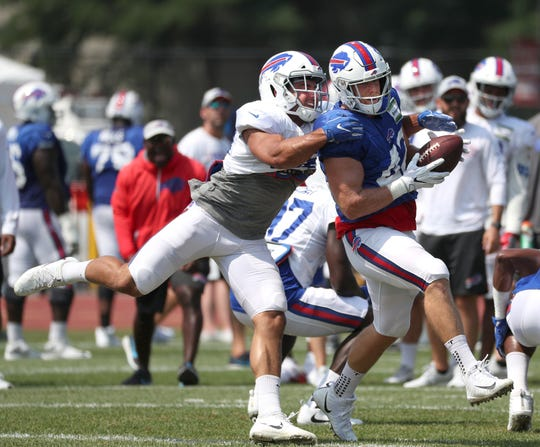 Bills fullback Patrick DiMarco catches a short pass in front of linebacker Matt Milano.