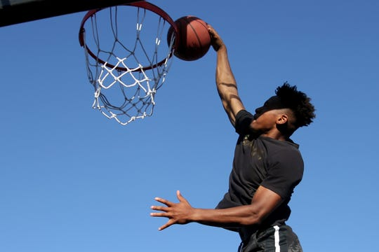 Jezreel Harper, of Portland, competes in the Hoopla Slam Dunk Contest outside the Oregon State Capitol in Salem on Saturday, Aug. 4, 2018.